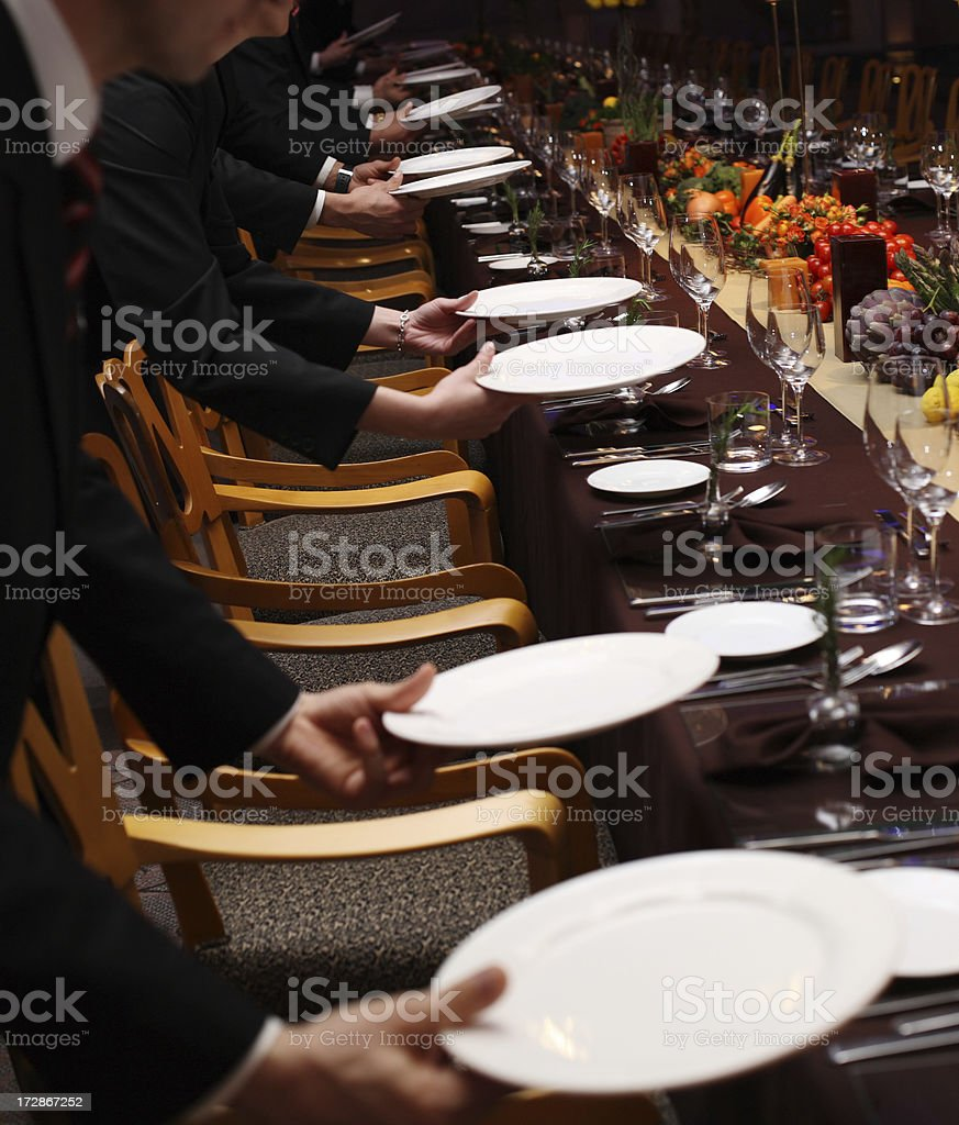 Waiters setting a table in a fancy restaurant stock photo