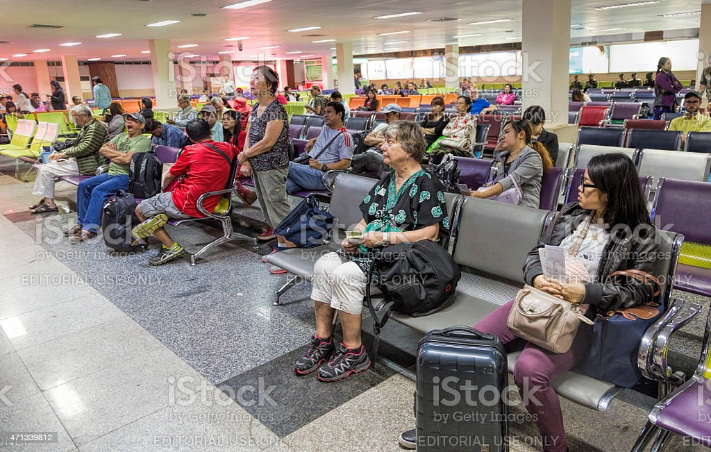 Waitin area in Yangon Airport, with tourists and Burmse people stock photo