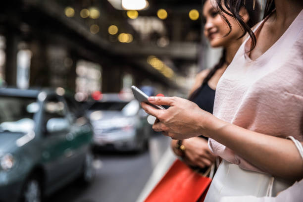 waiting and looking for a taxi ride - rideshare stock photos and pictures