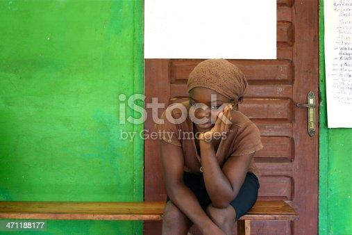 A young lady waiting to be seen at a clinic in rural Liberia, West Africa.