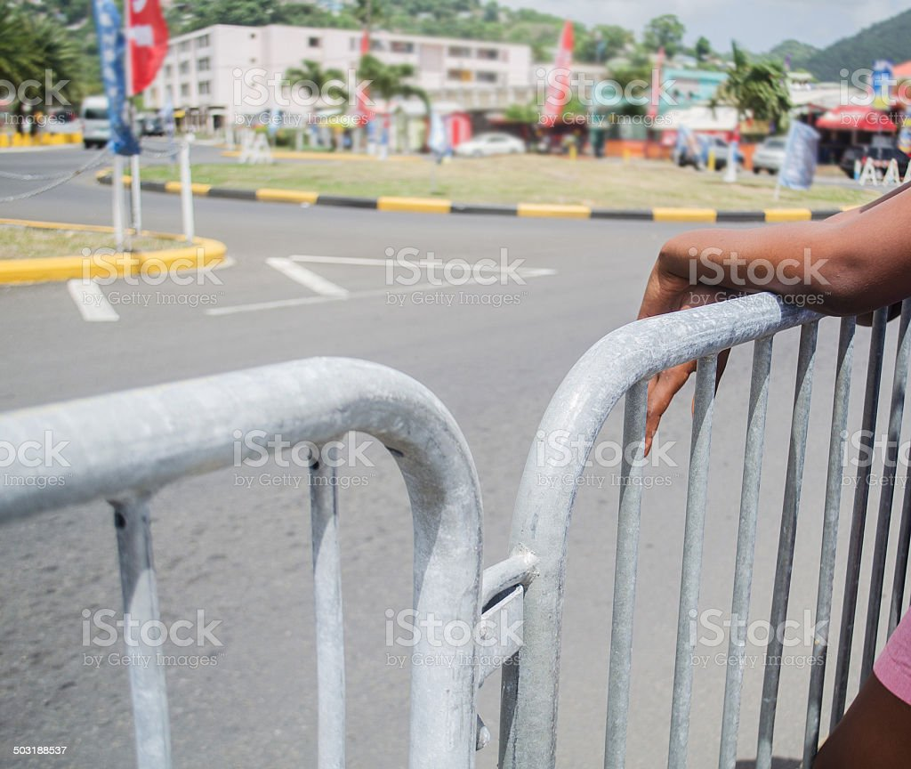 waiting behind barrier stock photo