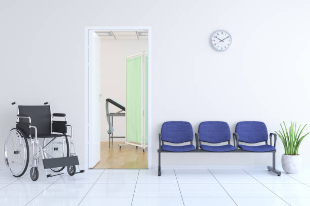 Waiting Bench and Wheelchair Outside Of Doctor's Room stock photo