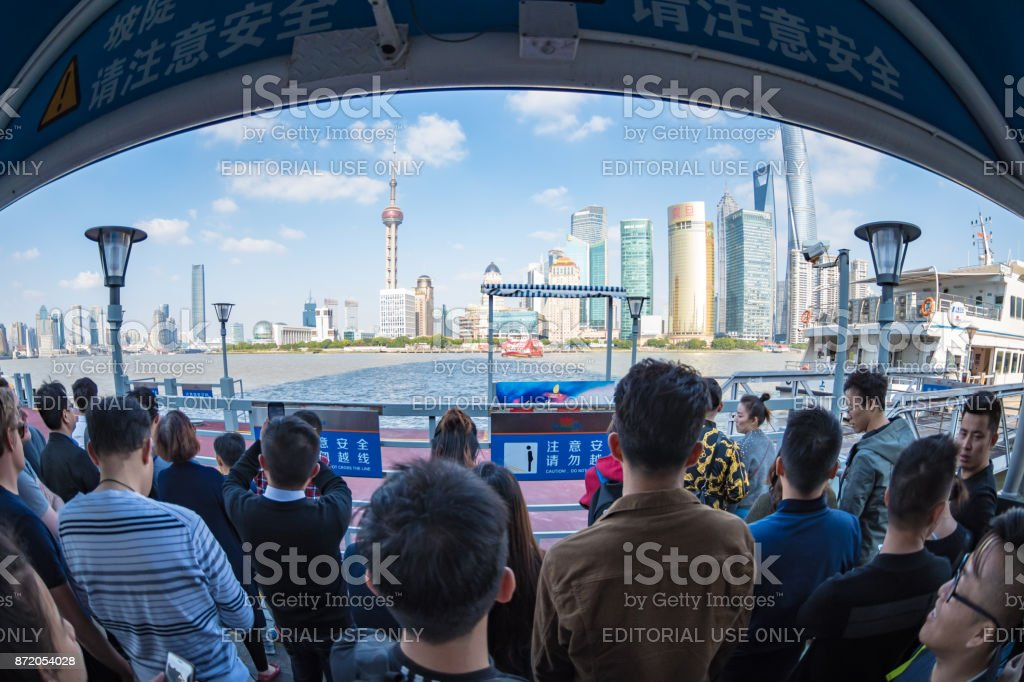Waiting for a ferry at The Bund in Shanghai stock photo