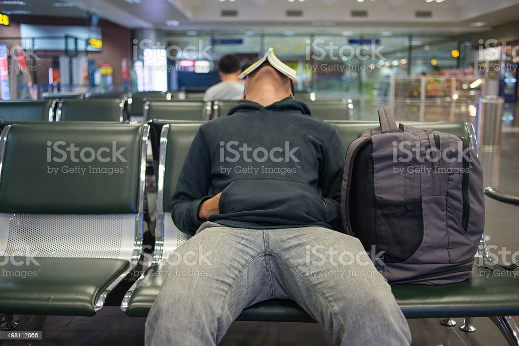 Waiting for a night flight in airport stock photo