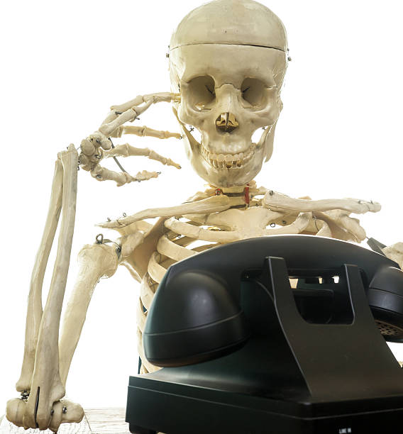 waiting for a phone call - human skeleton stock photos and pictures