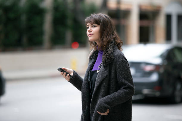 Waiting for a Rideshare or Checking Mobile Phone for GPS Navigation stock photo