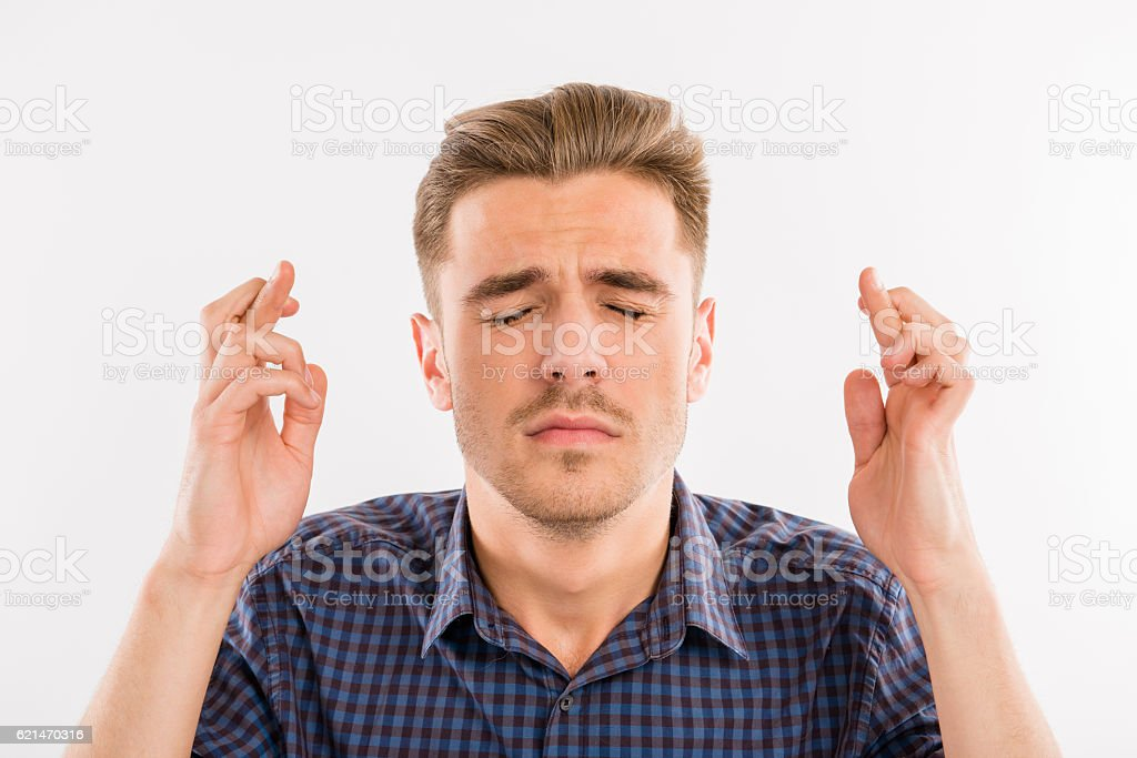 waiting for a special moment. man crossed his fingers stock photo