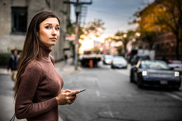 waiting for carpool in city street - rideshare stock photos and pictures