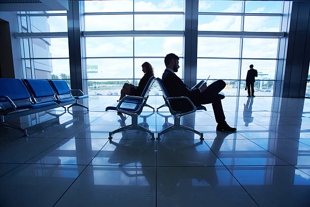 waiting for departure - leaving partnership corporate business sitting stock photos and pictures