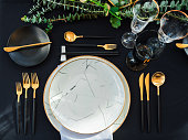 Black and gold color Luxury table set for Wedding reception in barn