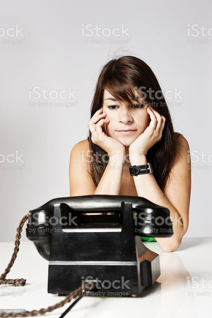 Waiting for him to call royalty-free stock photo