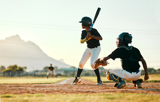 Shot of two baseball players in position during a game