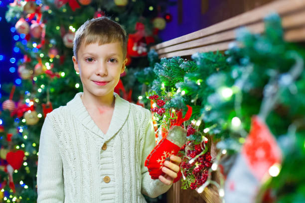 Waiting for present. Pleasant euphoric little boy and holding ha stock photo