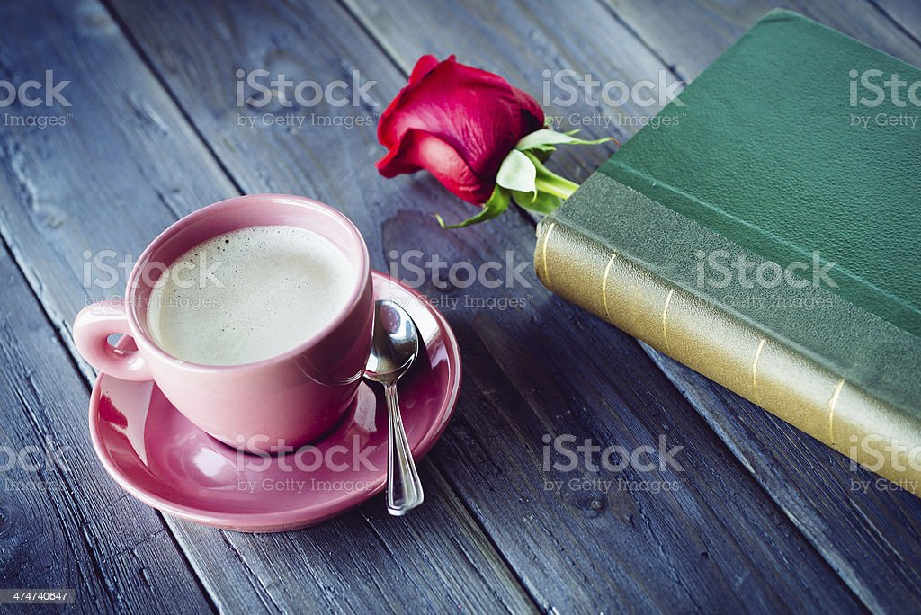 Waiting for romantic dating with rose and book