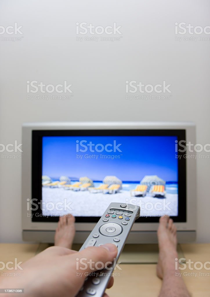 Waiting for summer in front af the tv. royalty-free stock photo