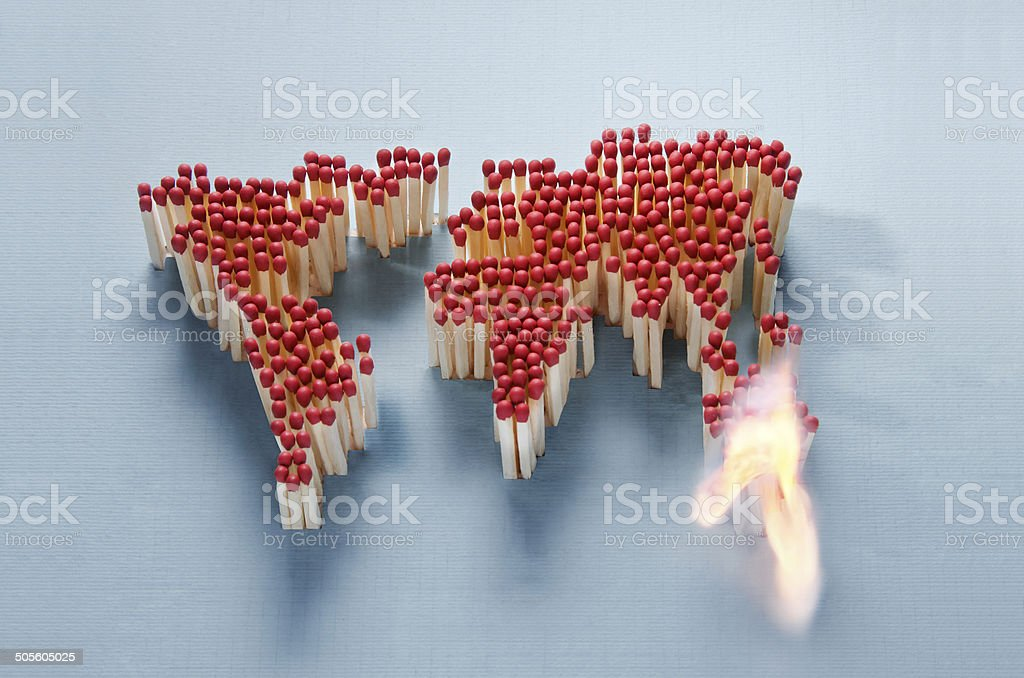 World map made of matches waiting for a spark