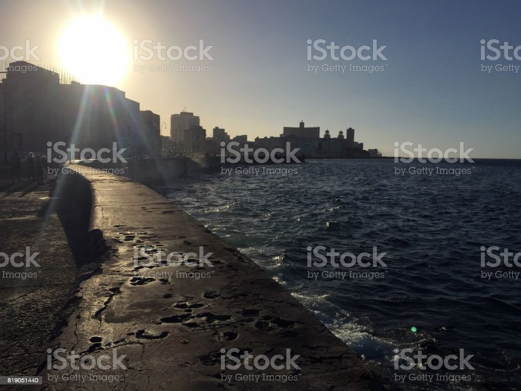 Waiting for the sunset on the Malecon stock photo
