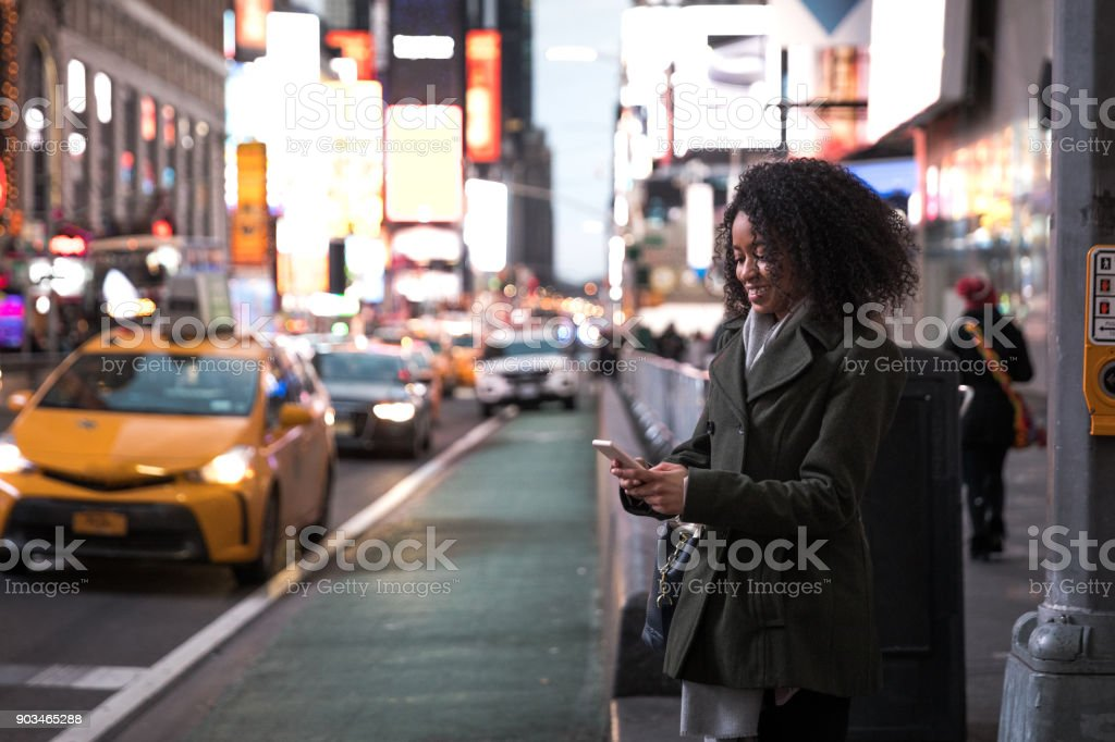 Waiting for the taxi in Times Square New York stock photo