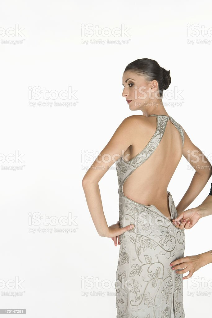 Waiting For Zip To Be Done Up On backless dress stock photo