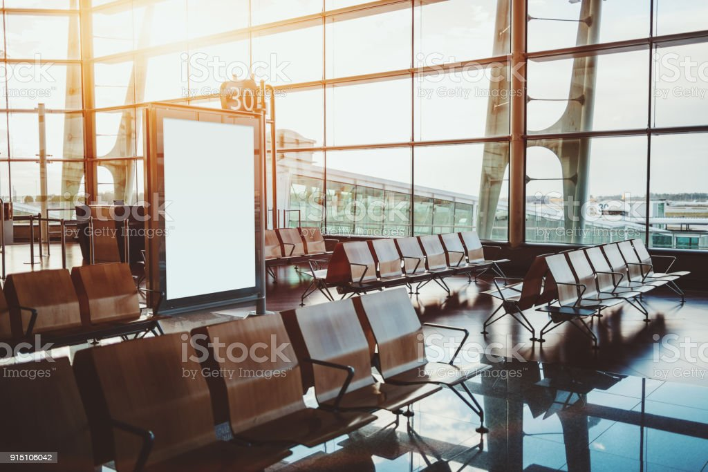 Waiting hall in departure zone of airport gate stock photo