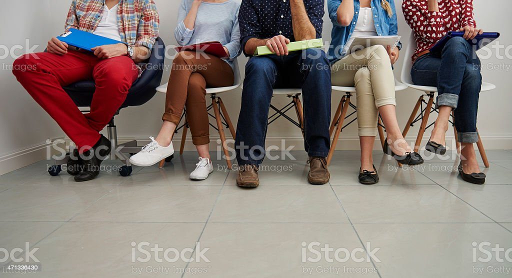 Waiting in the queue for job interview stock photo
