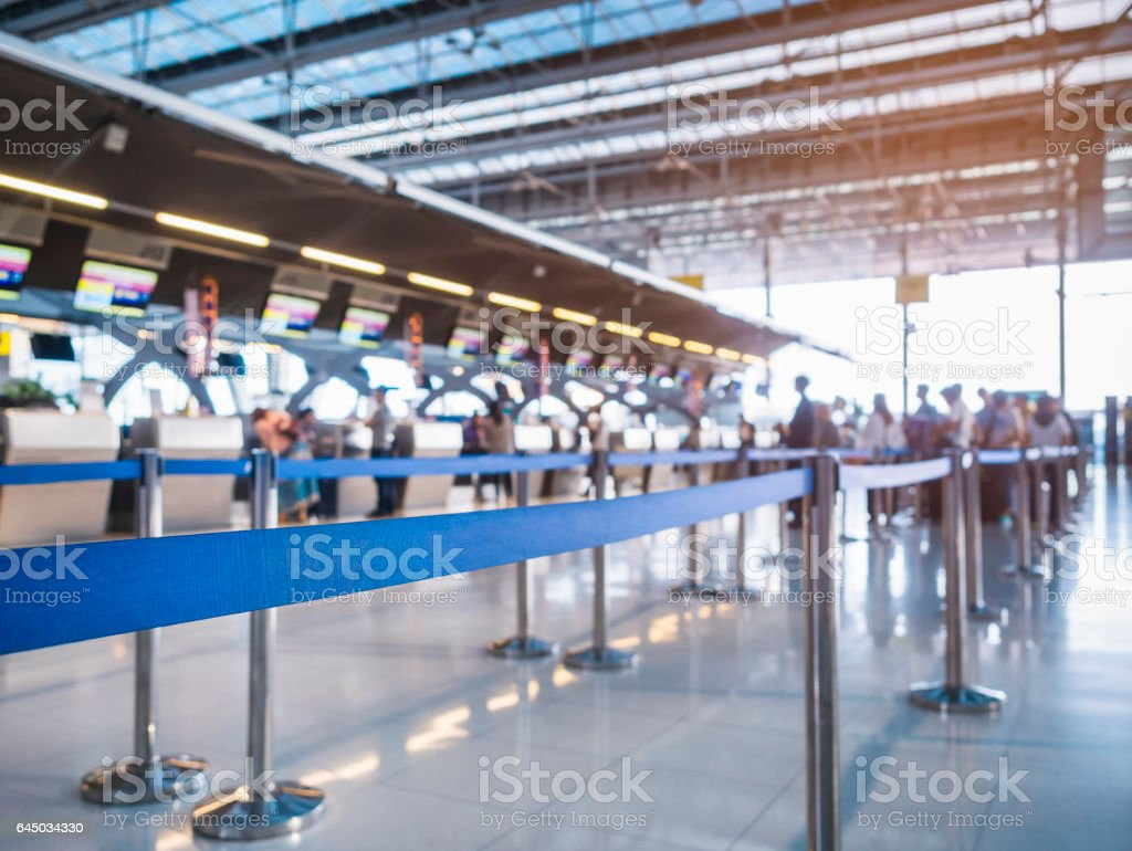 Waiting Lane Check in Counter with Blur People queue at Airport stock photo