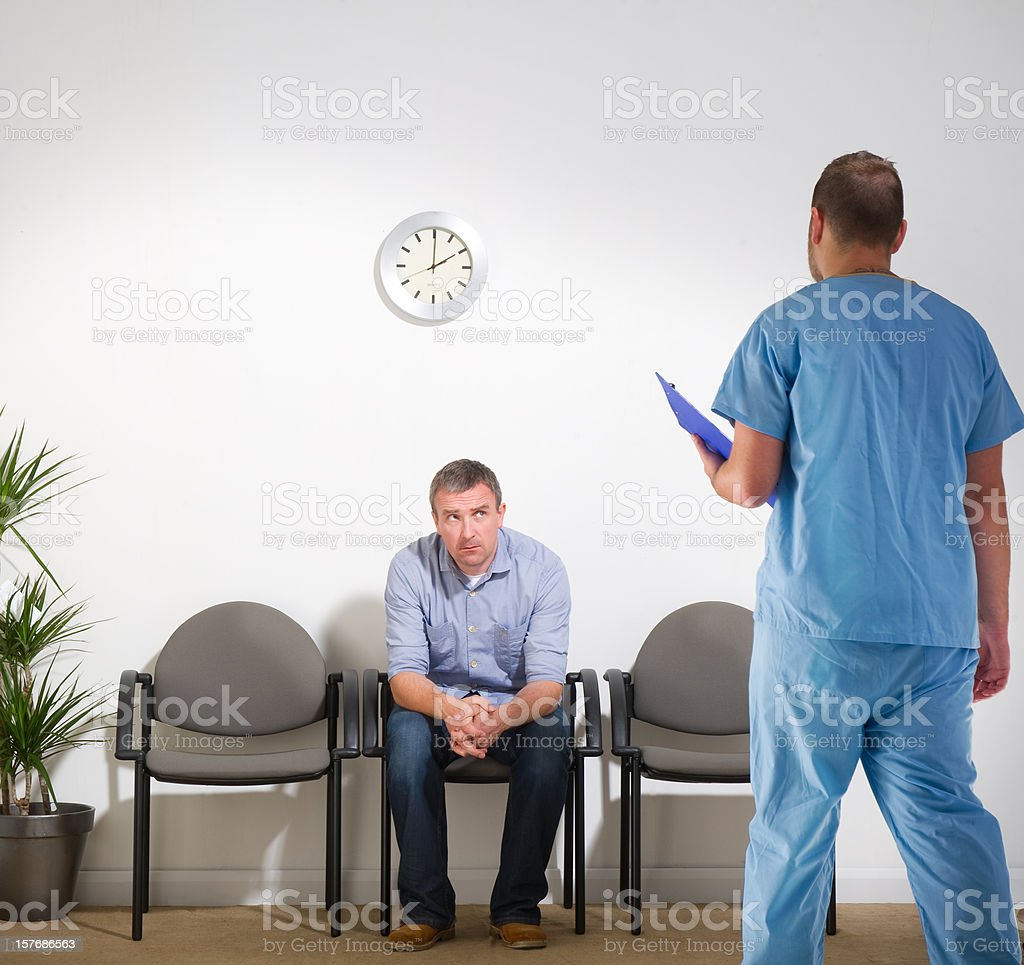 Waiting Man Getting News from a Surgeon royalty-free stock photo