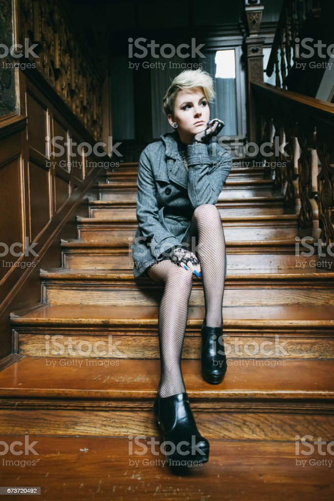 Waiting on old wooden Stairway Woman Portrait stock photo