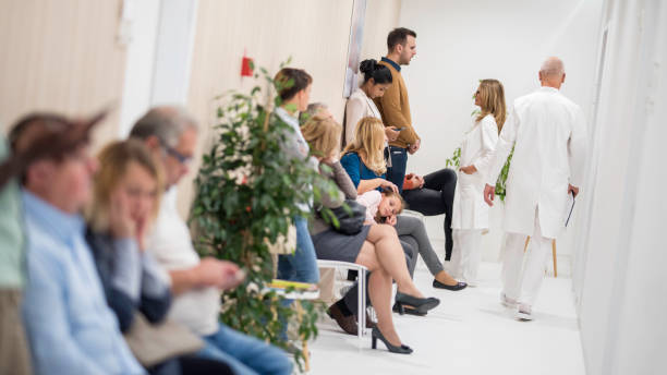 waiting room in a hospital - busy stock photos and pictures