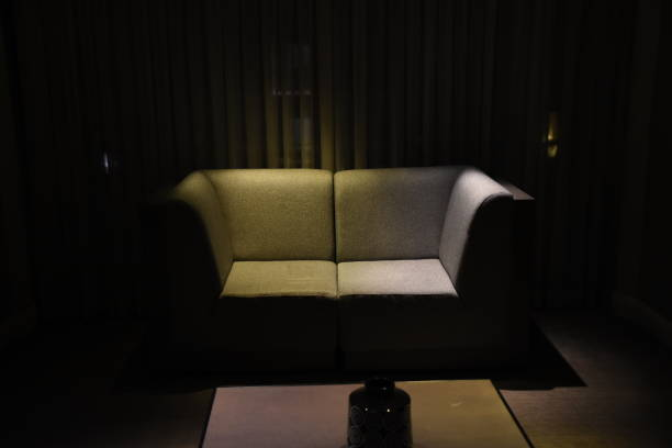 waiting sofa - low lighting stock photos and pictures