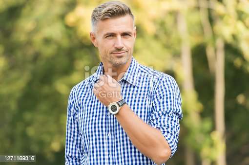 Waiting. Technologies concept. Counting time. Modern gadgets. Using smart watch. Modern lifestyle. Watch is reflection of status. Man check watch urban background. Handsome man wear wrist watch.