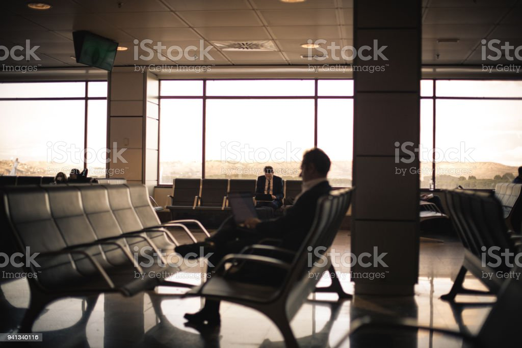 Waiting time. Businessman at airport.