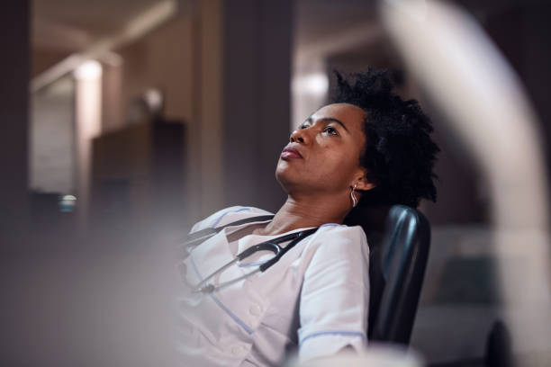waiting to her shift to be over! - debilitate stock pictures, royalty-free photos & images