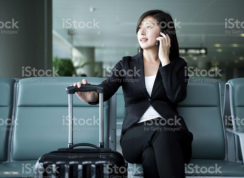 waiting traveller using mobile phone stock photo