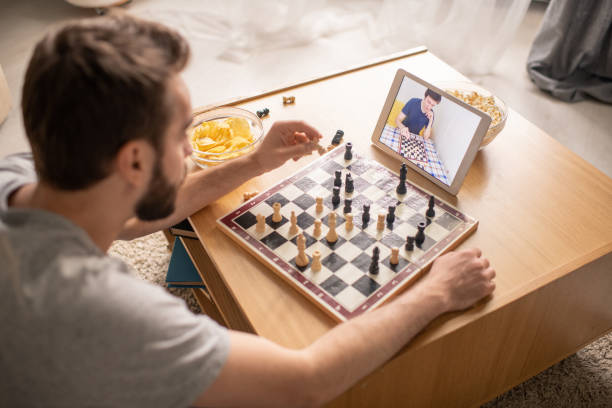 Waiting when competitor making chess move stock photo