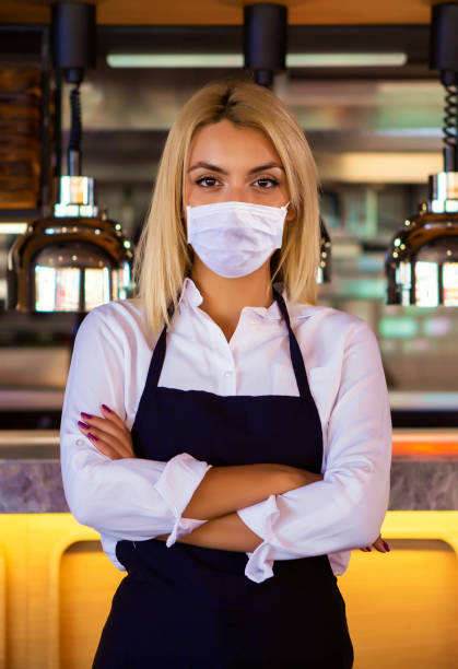 waitress at a coffee shop, coronavirus concept. - essential workers stock pictures, royalty-free photos & images