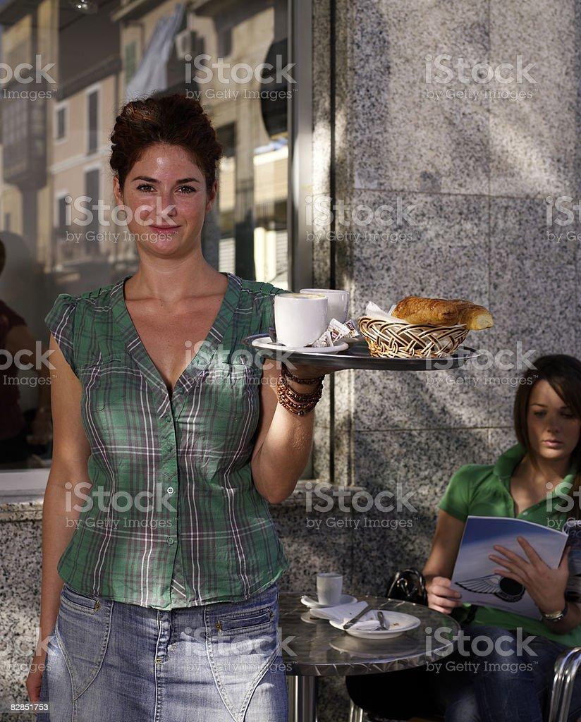 Waitress at cafe royalty free stockfoto