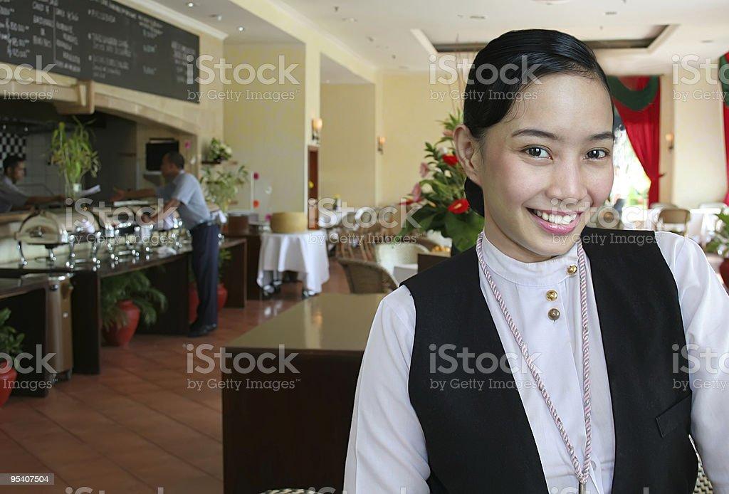waitress at work smiling royalty-free stock photo
