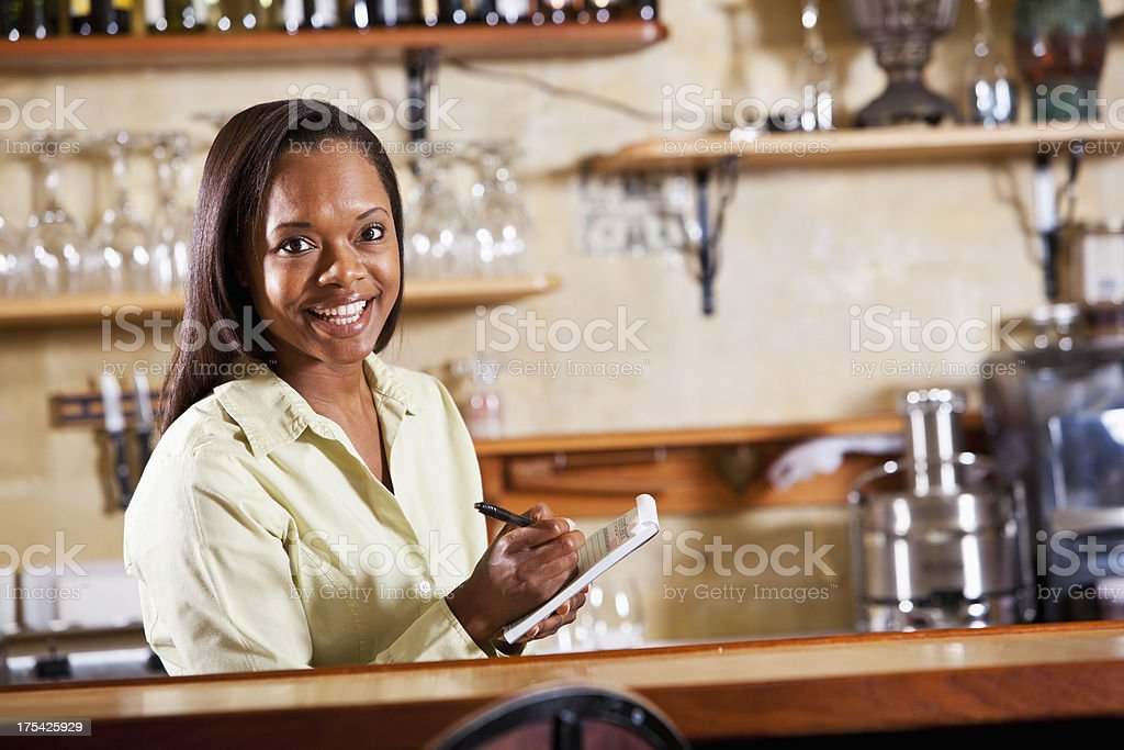 Waitress behind counter in restaurant royalty-free stock photo