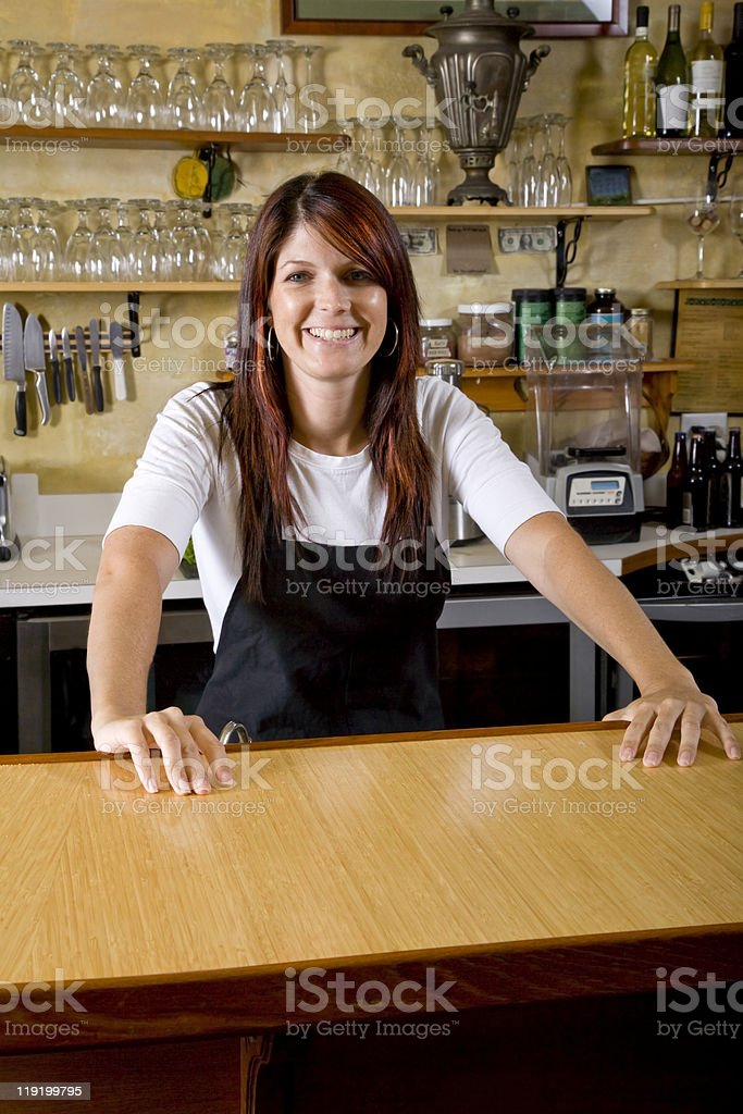 Waitress behind counter working in restaurant royalty-free stock photo