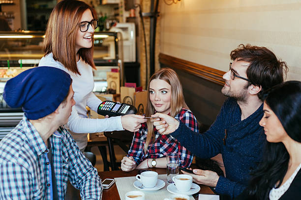 Waitress Charging Customers Bill stock photo