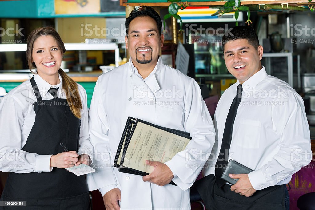 Waitress, chef, and manager in family owned Tex-Mex restaurant stock photo