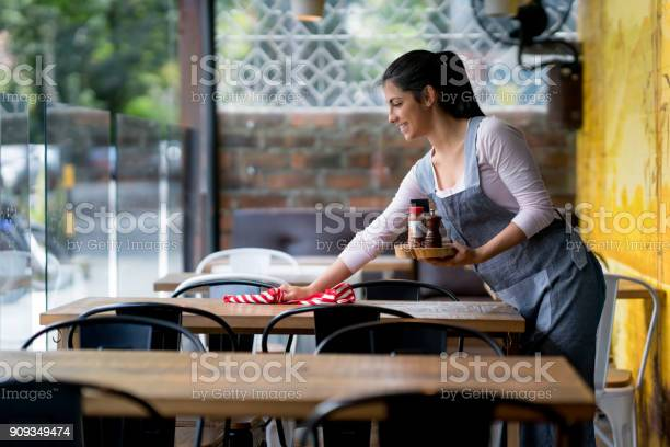 Waitress cleaning the tables at a restaurant picture id909349474?b=1&k=6&m=909349474&s=612x612&h=9x2sxgaijdffeonxe9gnmm46sniaalmfzh1umdsxor0=