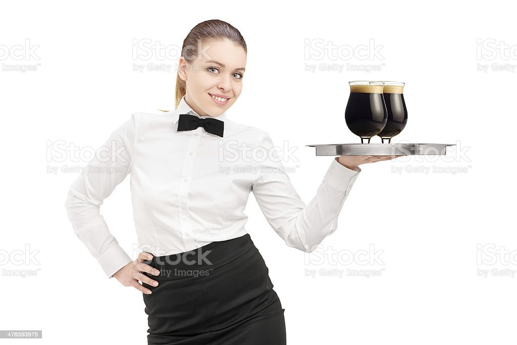Waitress holding a tray with two beers royalty-free stock photo