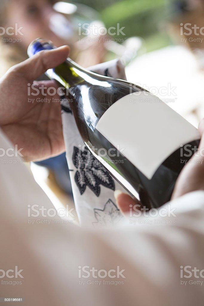 Waitress holding bottle of wine royalty-free stock photo