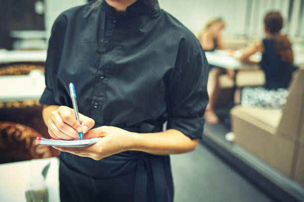 Waitress in a cafe taking the order stock photo