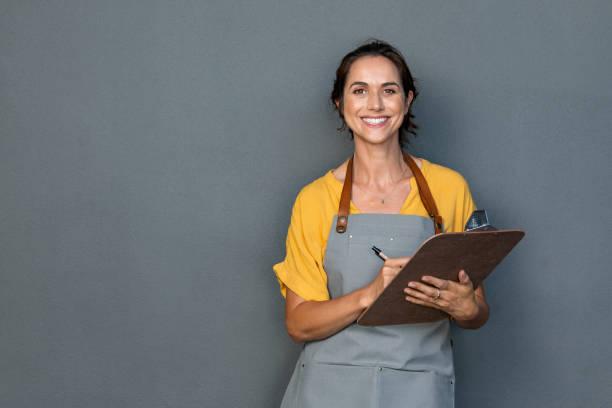 Waitress in apron take orders picture id1180925169?b=1&k=6&m=1180925169&s=612x612&w=0&h=8gxsiu4esmpdabf kuxkqb4btdn3tjd171ntturaqdm=