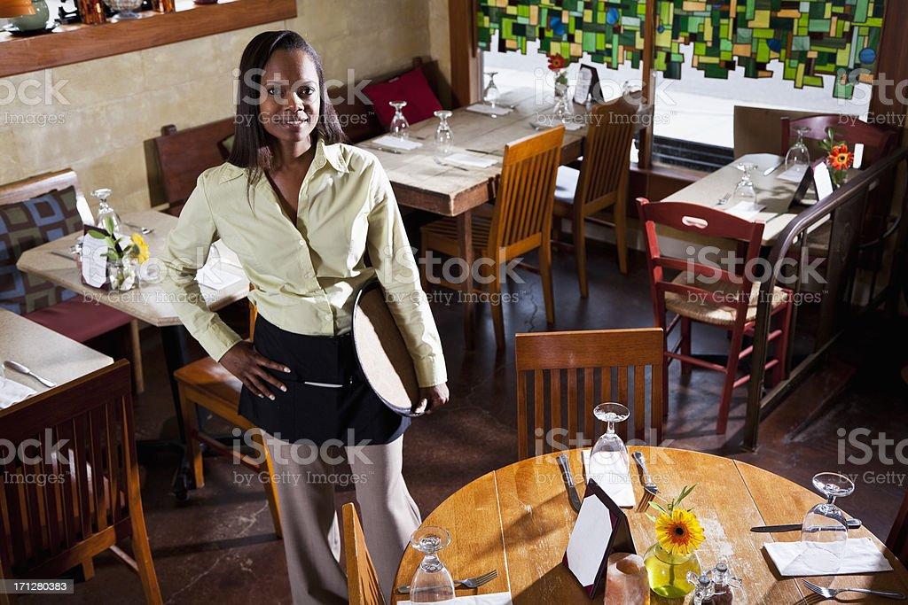 Waitress in restaurant royalty-free stock photo