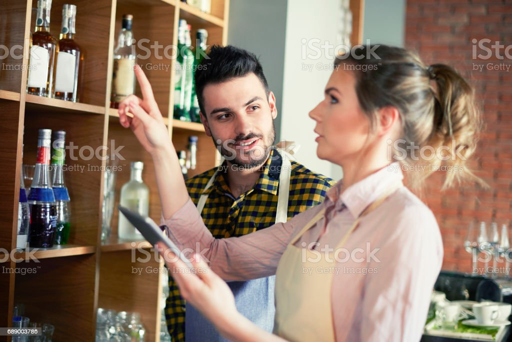 waitress making sure their business stands out stock photo