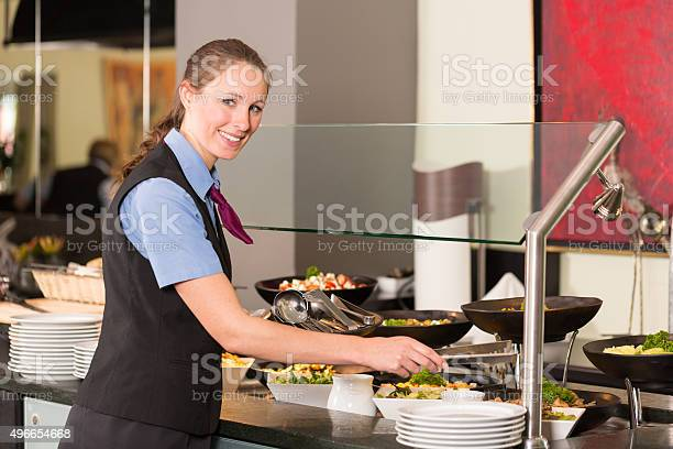 Waitress or catering professional putting food into buffet picture id496654668?b=1&k=6&m=496654668&s=612x612&h=ylmpd9gasopkzhpb2pdnr6glgowuxv6fekbxamu8t7g=